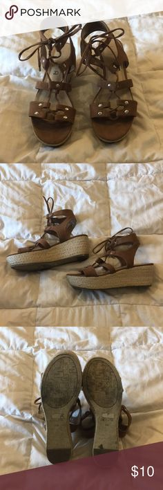 Unisa Brilee 7.5 wedge gladiator sandals The wedge is 2.5 inches at the highest point.  Brown suede-like upper with woven/corky wedge.   These are in great condition; worn 2-3 times in a big city so the soles look dirtier than they may otherwise.  No box. Unisa Shoes Sandals
