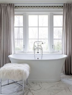 Clean & bright. Love the tub & seat. Designed by Tiffany Eastman Interiors. #laylagrayce #bathroom