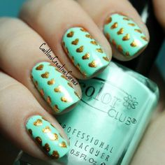 Teal nails with gold hearts - a non-pink-and-red Valentine's idea!