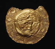 Golden pendant with a portrait of Alexander the Great, found at Aboukir, Egypt, 4th century AD. Walters Art Museum, Baltimore.