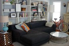 I want to turn our formal living room into a more casual room with a dual purpose...Enter billy bookcases. I love this mimicked built-in look.