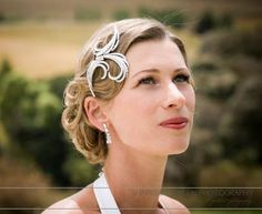 1940s glam  with great brooch  Hair and makeup Hil Cook