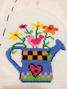 Colorful cross-stitch flowers
