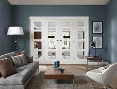 http://www.doorsofdistinction.co.uk/interior_doors/images-pairs-divider_doors/images_large/freefold-white-shaker4-doors.jpg