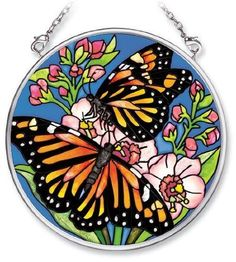 Amia 5481 Hand Painted Glass Suncatcher with Butterfly Design, 3-1/2-Inch Circle by Amia. $10.00. Includes chain. Handpainted glass. Comes boxed, makes for a great gift. Amia glass is a top selling line of handpainted glass decor. Known for tying in rich colors and excellent designs, Amia has a full line of handpainted glass pieces to satisfy your decor needs. Items in the line range from suncatchers, window decor panels, vases, votives and much more.