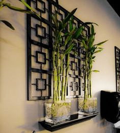 Beautiful Bamboo Plant display! I could adapt this outside with a trellis and larger pots