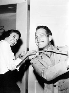 """Jean Simmons and Paul Newman on the set of """"Until They Sail""""."""