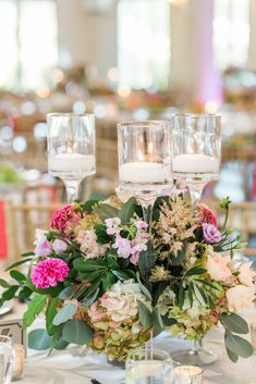 Low bright garden wedding centerpieces designed by Edge Design Group