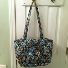Vera Bradley Tote Favorite pattern! 2 exterior pockets. 2 straps show wear. One compartment with tons of pockets. Zippered closure. No stains. Measures 11.5x6x14.5 Vera Bradley Bags Totes