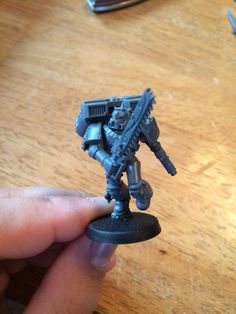 Deathwatch blood angel armed with master crafted chain sword and bolt pistol
