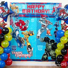Create a birthday battle ground for your boys with a Transformers party scene setter & balloons! Click the pic to learn how to make these cool *double helix* spiral balloon columns!
