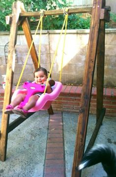 Use 2x4's, nails, and any swing you want  to make your toddler a swing set! Here's our swing set and our daughter loves it.