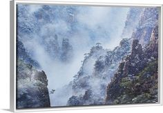 Featuring the famed Chinese mountain range, this dream-like canvas print in a white floating frame will transform any room. See more at GreatBIGCanvas.com