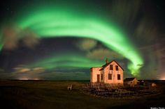 Abandoned farm in Iceland encircled with Aurora Borealis