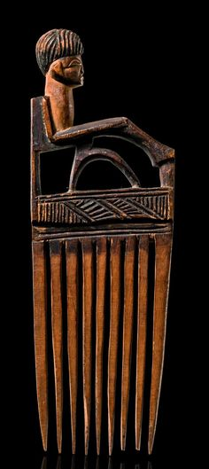 Africa | Hair comb from the Chokwe people of DR Congo | Wood, with blackish brown patina