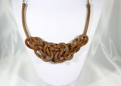This leather necklace was made by a unique technique. The necklace was made by natural material, theres no artificial colouring added.  Perfect gift to anyone, you can ask for bracelets and earrings as well to make your set complete.  Keep this product away from water and hot items. Necklace should not be immersed in water, as it can lose its shape. Please, do not wear while sleeping, swimming, bathing, etc. If you have questions or feedback, feel free to contact me.  Each piece is handmade…