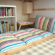 Learn how to make this simple folding floor cushion from some fabric and standard pillows. A must for any reading nook or children's room.