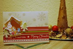 Handmade Christmas card with a gingerbread house and a 3D snowman sticker