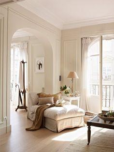 wood floor, large windows open to long balcony