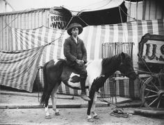 Creator: H.F. Cooper Photographer, Strabane Date: c.1910 Original Format: Glass Plate Negative Description: Man on a horse outside a circus PRONI Ref: D1422_B_17_48~ALL~A Copying and copyright: Please see www.proni.gov.uk/index/research_and_records_held/copying_... For Copy Orders, contact: Email: proni@dcalni.gov.uk For fees and charges see: www.proni.gov.uk/index/about_proni/are_there_any_fees_and...