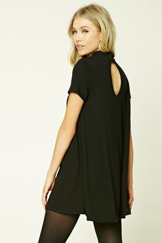 A lightweight knit mini swing dress featuring a mock neck, short sleeves, and a back keyhole cutout.