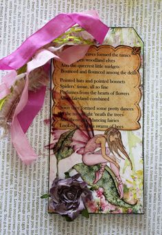 Tag art swap, theme: Fairies & Fauna rosesonmytable.ning  In the garden - a sweet poem about fairies working the magic in the garden.  The fairy has transparent wings, the affect is seen when you look where they cover the leaf and poem behind her.