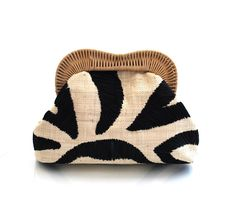 By Kayu Kelly ,straw Clutch features hand embroidered raffia and a wicker frame.via Pinterest .
