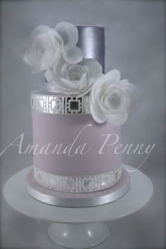 Metallics & Wafer Paper cake. Lilac, pink, white, edible silver leaf patterned border, wafer paper flowers, metallic painted tier. www.amandapennycakes.com