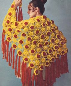 Stunning wrap! That would make a fun crochet project, especially if beads got added to the ends of the fringe!