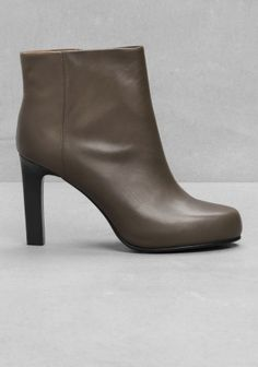 7893a724fca4fa A pair of versatile ankle boots with understated design and feminine  silhouette.