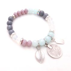 Semi precious dyed jade and faceted glass beads have been combined with Greek ceramic washers to create this gorgeous bracelet. Adorned with a Swarovski crystal rondelle, silver leaf and a Turkish coin charm.Wear it on its own or layer it up with more Cassie Louise bracelets and add a Cassie Louise necklace to complete your outfit.Length: XS - elasticised band will fit 15-17cm wristAll Cassie Louise pieces are handmade with love in Melbourne and are adorned with our sign...