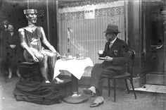 """""""The first artificial human machine with its inventor, the English Captain WH Richards, in the conservatory in Berlin. The """"robot"""" can speak, turn its head, hold objects and bow. It is made of steel."""" 1930 - German Federal Archive"""