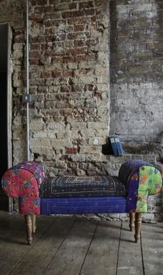 Beautiful little bench upholstered in a patchwork of Indian tribal fabrics and embellished with colourful stitching. Practical storage space is concealed under the hinged seat.