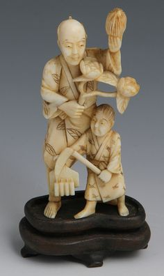 """Description: JAPANESE CARVED IVORY OKIMONO FARMER & SON Japanese carved ivory okimono of farmer father and son, depicted holding a variety of agricultural objects. Monochrome detail, unsigned. Weight: 51g Size: 4"""""""