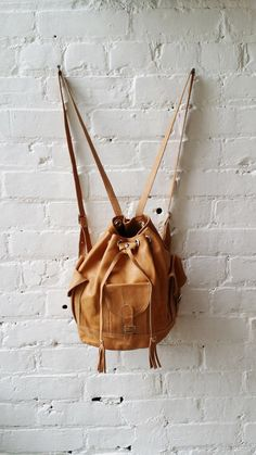 VTG Soft Camel Leather Drawstring Backpack by UrbanXchange on Etsy, $38.00