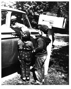 Rural Carrier Greeted by Children by Smithsonian Institution, via Flickr