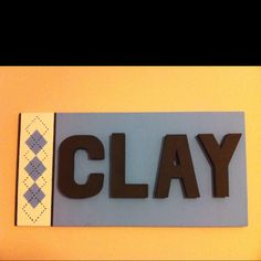 Name sign: painted canvas, painted cardboard letters. My take in UNC decor
