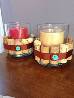 cork candle holders!! cut the corks in half, hot glue to glass candle holder (I got it from the dollar store), add ribbon & buttons for cute candle holders!