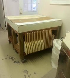 Kiln shelf storage - under table