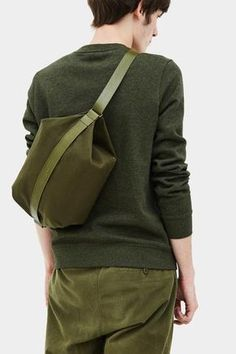 Thisispaper Transfer Bag Army Green : Read about Design & Production Transfer bag has a closing zipper with leather cover strap on the top, two interior pockets for personal organizing, interior My Bags, Purses And Bags, Leather Accessories, Women Accessories, Fashion Bags, Mens Fashion, Creation Couture, Fabric Bags, Clutch