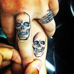 mine and my loves matching skull on wrist and middle finger. #tattoos
