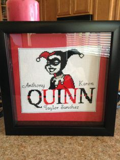 Cross stitched names in a shadow box as personalized gifts