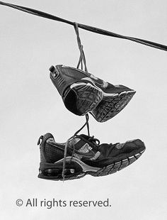 Shoes on a wire.