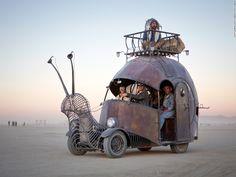 """Artists Jon Sarriugarte and Kyrsten Mate built this snail-shaped art car on top of a 1966 VW Beetle floor pan….   History of Burning Man Motors"