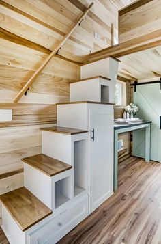 This is the Clover Tiny House on Wheels by Modern Tiny Living. It's a beautiful tiny home with a multifunctional booth, couch, and first floro bedroom area. Tiny House Stairs, Shed To Tiny House, Tiny House Loft, Tiny House Storage, Best Tiny House, Modern Tiny House, Tiny House Living, Tiny House Plans, Tiny House On Wheels