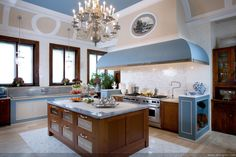 Fantastic Kitchen Design with Cream Combined Blue Wall Paint Color and Cool Granite Countertop Idea and Brown Wood Storage Drawers Cabinet Set and Fancy Chandelier Lights and Chrome Stylish Sink