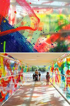 Children paint plexiglass and make an outdoor exhibit for them to walk through. Viachroma by Rowena Martinich: Pedestrians are enveloped in colored lights and shadows as sunlight passes throught at different times of day.