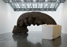 Anish Kapoor, She Wolf, 2016. Resin and earth, 107 x 355 x 209 inches (270 x 900 x 530 cm). Pedestal: 78 2/4 x 118 1/8 x 98 1/2 inches (200 x 300 x 250 cm). Installation View: Today You Will Be In Paradise, May 4 - June 11, 2016. Gladstone Gallery, New York. Courtesy Gladstone Gallery, New York and Brussels. Photo: David Regen.