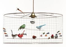 I believe i know a girlchild whod quite like a birdcage light cage like lamps filled with ornamental birds are on display at the challieres stand wire lampshadeinterior lightingpendant keyboard keysfo Choice Image
