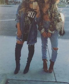 camo jacket, blue knee ripped jeans, and black thigh high boots image